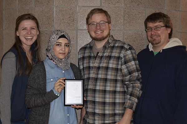 Physics student winners of 2nd place booth