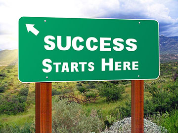 Success Starts Here Road sign